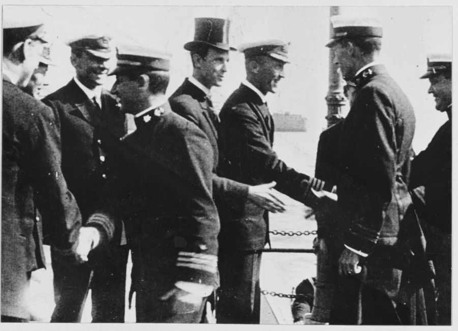 893b. Mr Wesley Frost, American consul, and British Naval officers greeting Commander Taussig and the other officers of the destroyer flotilla upon their arrival in Queenstown, May 4, 1917.
