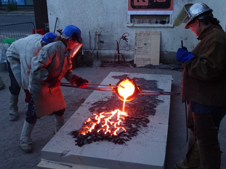 US artist Tamsie Ringler begins pouring the molten ore for her River Lee iron casting sculpture at the National Sculpture Factory, Cork, July 2018