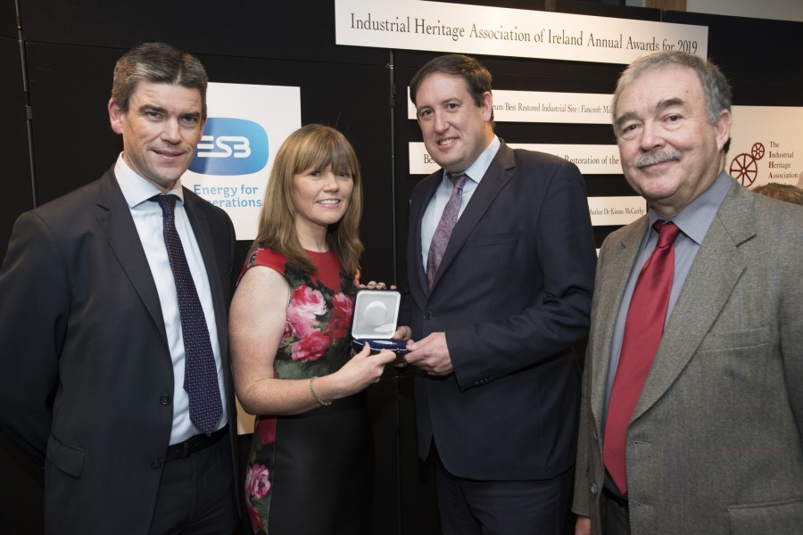 Nicholas Tarrant, Executive Director ESB, Engineering and Major Projects, Mary Liz McCarthy, Dr Kieran McCarthy, winner of the Mary Mulvihill Publication / Media Award 2019, and Paul McMahon, President, IHAI.IHAI Awards 2019 sponsored by ESB, Venue ESB Archive, St Margaret's Road, Finglas, Dublin. Wed 11th Dec 2019 - Photograph by WovenContent.ie