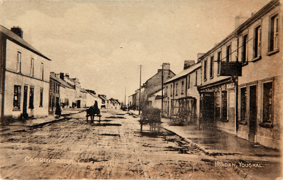 1030a. Main Street, Carrigtwohill, c.1920 with the prominent RIC Barracks building just right of centre